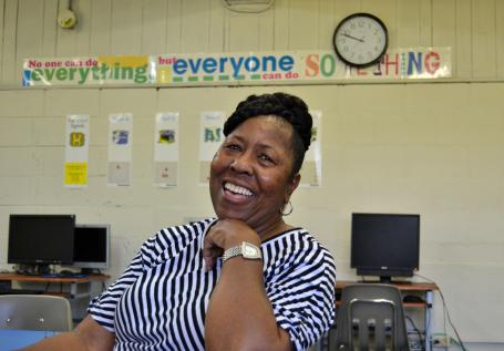 Minnie Likely, head of the North Port St. Joe Community Youth Initiative, smiles at the after-school program she runs at the former George Washington High School.